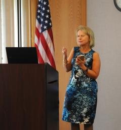 Janice Duvall standing and speaking